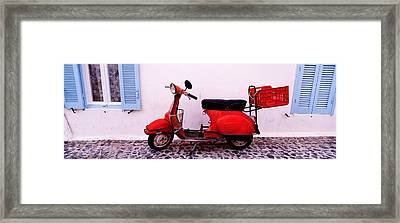 Motor Scooter Parked In Front Framed Print by Panoramic Images