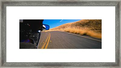 Motorcycle On A Road, California, Usa Framed Print