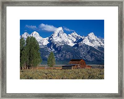 Moulton Barn Tetons Framed Print by Leland D Howard