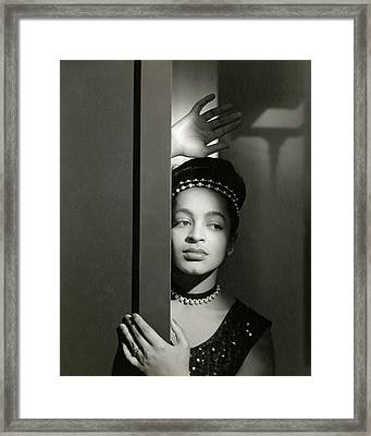 Moune Posing By A Wall Framed Print by Horst P. Horst