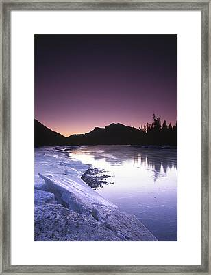 Mount Mcgillvary Silhouetted Behind An Icy Bow River Framed Print by Richard Berry