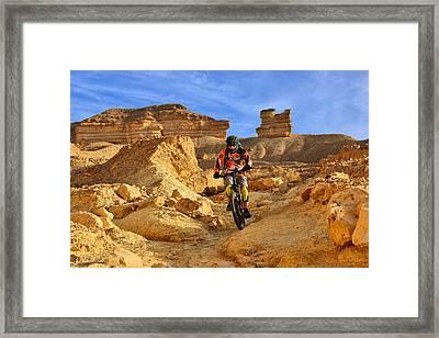 Mountain Biker In A Desert Framed Print