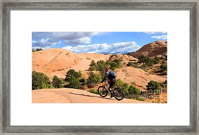 Mountain Biking Moab Slickrock Trail - Utah Framed Print by Gary Whitton