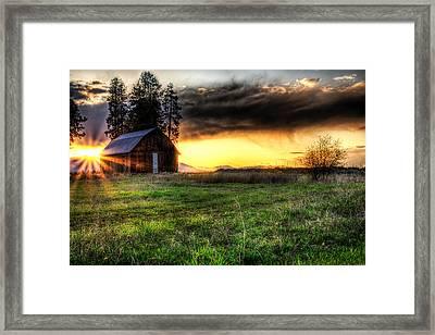 Mountain Sun Behind Barn Framed Print by Derek Haller