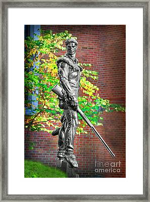 Mountaineer Statue Framed Print by Dan Friend