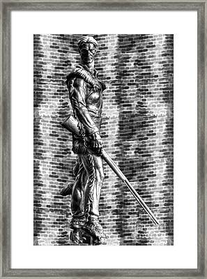 Framed Print featuring the photograph Mountaineer Statue With Black And White Brick Background by Dan Friend