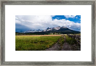 Framed Print featuring the photograph Mountains And Fence by Jay Stockhaus