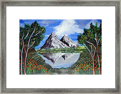 Mountains On A Lake Framed Print by Saranya Haridasan