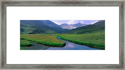 Mountains Surrounding A Stream Framed Print by Panoramic Images