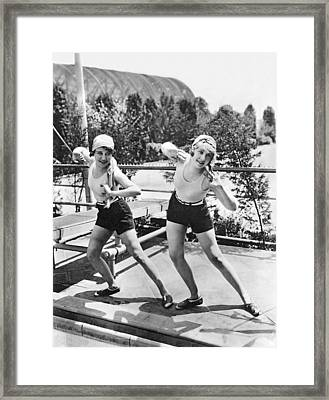 Movie Stars Exercising Framed Print by Underwood Archives