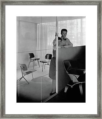 Mr And Mrs Charles Eames At The Museum Of Modern Framed Print by George Platt Lynes