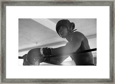 Muhammad Ali Gloves Resting On Ropes Framed Print by Retro Images Archive