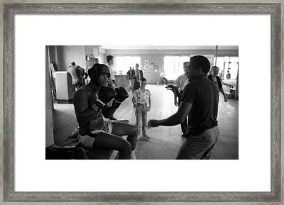 Muhammad Ali Guards Up Framed Print by Retro Images Archive