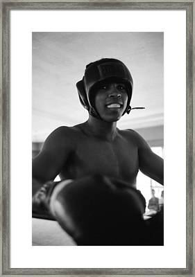 Muhammad Ali Looks Into Camera Framed Print by Retro Images Archive