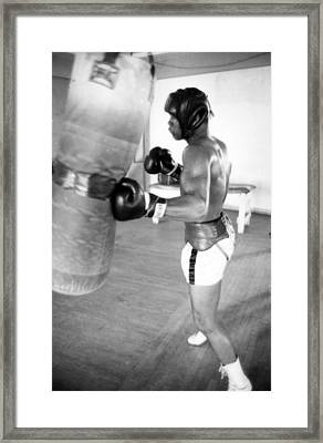 Muhammad Ali Punching The Heavy Bag Framed Print by Retro Images Archive