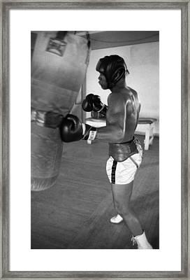 Ali Punching Bag Framed Print