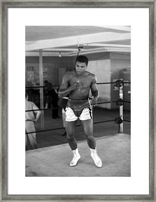 Muhammad Ali Warming Up Framed Print by Retro Images Archive