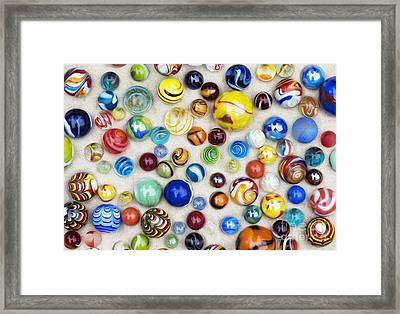 Multicoloured Marbles Framed Print by Tim Gainey