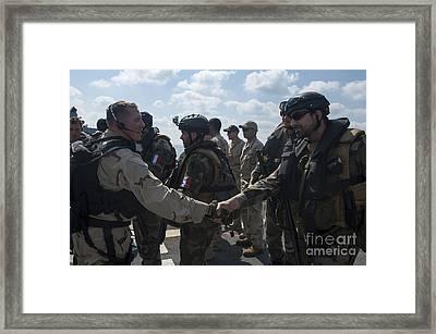 Multinational Forces Hake Hands Framed Print by Stocktrek Images