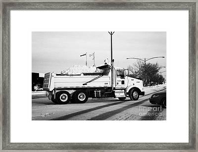 municipal city dump truck taking away snow cleared from parking lots and roads in Saskatoon Saskatch Framed Print