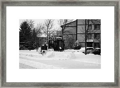 municipal city mini tractor clearing sidewalks and roads in Saskatoon Saskatchewan Canada Framed Print