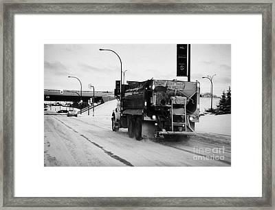 municipal city truck spreading grit and salt on roads in Saskatoon Saskatchewan Canada Framed Print