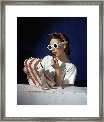 Muriel Maxel Applying Lipstick Framed Print by Horst P. Horst