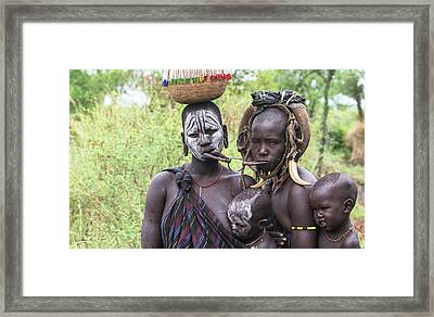 Mursi Lips Without Plates Inserted Framed Print by Peter J. Raymond