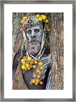 Mursi Woman With Lip Plate And Body Art Framed Print by Tony Camacho