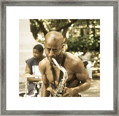 Music In The Park Framed Print by Menachem Ganon