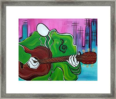 Music Man Framed Print by Laura Barbosa