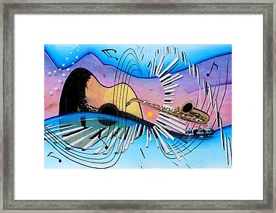 Musica Framed Print by Angel Ortiz