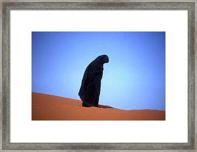 Muslim Woman Praying On A Sand Dune Photo Framed Print by .