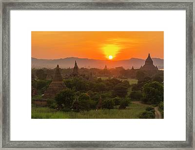 Myanmar Bagan Sunset Over The Temples Framed Print by Inger Hogstrom