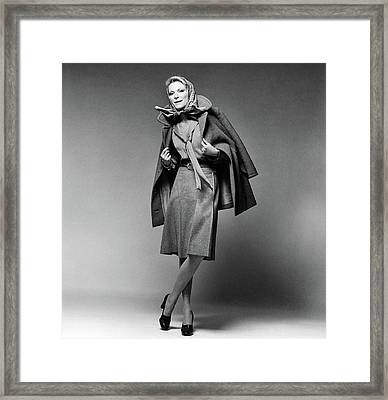 Nan Kempner Wearing A Pea Jacket And Skirt Framed Print