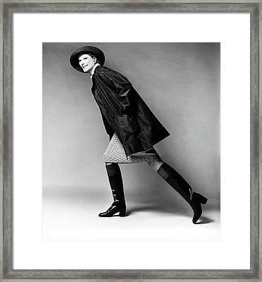 Nan Kempner Wearing A Raincoat And Hat Framed Print