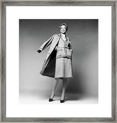 Nan Kempner Wearing A Wearing A Cardigan Framed Print by Francesco Scavullo