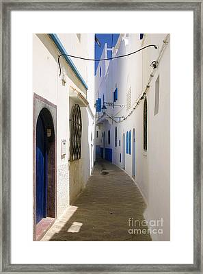 Narrow Backstreet In The Medina Of Asilah On Northwest Tip Of Atlantic Coast Of Morocco Framed Print by PIXELS  XPOSED Ralph A Ledergerber Photography