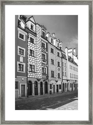 Narrow Houses Framed Print by Arkady Kunysz