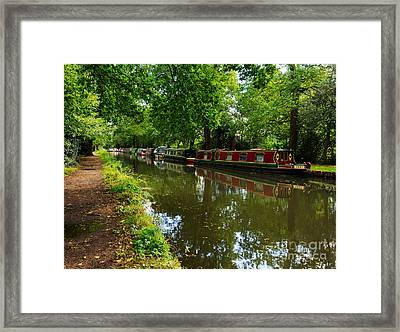 Narrowboats Moored On The Wey Navigation In Surrey Framed Print by Louise Heusinkveld