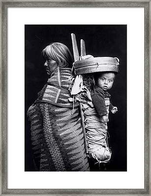 Navaho Woman Carrying A Papoose On Her Back Framed Print by William J Carpenter