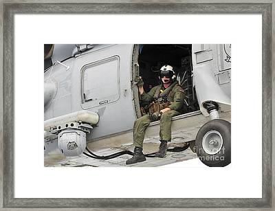 Naval Aircrewman Acts In An Sh-60b Sea Framed Print by Stocktrek Images