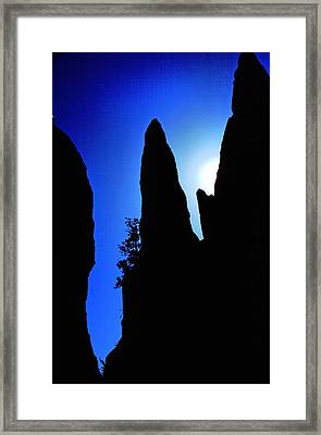 Needle Rock Framed Print