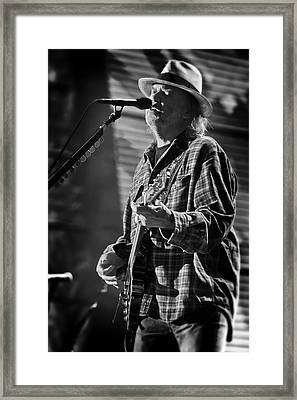 Neil Young Singing And Playing Guitar In Black And White Framed Print by Jennifer Rondinelli Reilly - Fine Art Photography