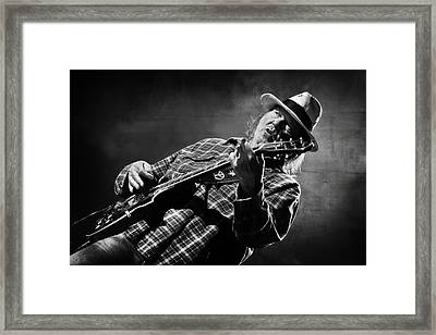 Neil Young On Guitar In Black And White  Framed Print by Jennifer Rondinelli Reilly - Fine Art Photography