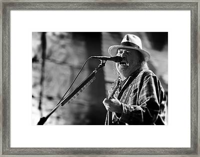 Neil Young Performing At Farm Aid In Black And White Framed Print by Jennifer Rondinelli Reilly - Fine Art Photography