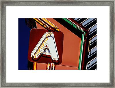 Framed Print featuring the photograph Neon A - Aztec Theater by Daniel Woodrum