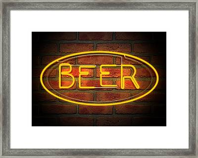 Neon Beer Sign On A Face Brick Wall Framed Print
