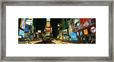 Neon Boards In A City Lit Up At Night Framed Print