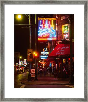 Neon Sign Lit Up At Night In A City Framed Print by Panoramic Images